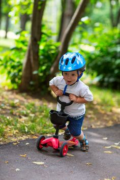 boy in helmet on a кick scooter
