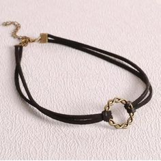 Black suede chocker with charm Charm antique gold with black suede chocker FIRM PRICE Jewelry Necklaces