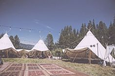 """We've Never Seen Wedding Tents Done Like This Before #refinery29  http://www.refinery29.com/brit-castanos-wedding-pictures#slide-3  Here's a view of the tents with the rug-covered dance floor. """"We enlisted Shelter Co. to provide gorgeous tents for our wedding party to sleep in throughout the weekend, and a slew of equally talented other vendors who turned the meadow into a magical, bohemian festival oasis,"""" says Castanos-Osborne. ..."""