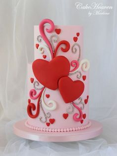 I usually go for a romantic or cute look for Valentine's day, however for this Valentine's cake I chose a whimsical design, in a colour combination of pinks and red. Photography by – Joseph Debattista Valentines Day Cakes, Valentine Desserts, Pretty Cakes, Beautiful Cakes, Fondant Cakes, Cupcake Cakes, Heart Cakes, Holiday Cupcakes, Just Cakes