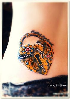 Gorgeous Lock Tattoo (without the woman's face)...this would be a cool cover-up.  I could have a key next to it with Kinsleigh's name on it...hmmm
