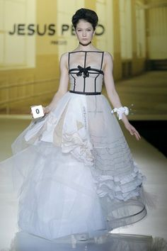 Jesus Peiro 2014: asymmetrical wedding gown. Love the black straps over nude bustier top but hate the rest.