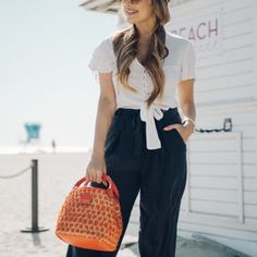 d010e0c2effb Complete your summer look with this cheerful bucket bag. Jaunty pom poms add  playful panache