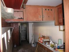 This is a view into the kitchen area. The stove and sinks were removed in the 1950's. I've posted an old photo taken from the same view of what the kitchen looked like back in the 1920's.