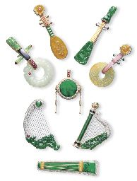 A GROUP OF CHINESE MUSICAL INSTRUMENT JEWELLERY, Designed as seven string instruments and a drum, set with vari-shaped jadeite of emerald green, green, russet, yellow and celadon colours, with diamond and gem-set details