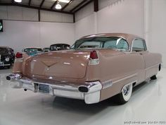 1956 CADILLAC COUPE DEVILLE SPECTACULAR RESTORATION! RARE COUPE DEVILLE TOP OF THE LINE MODEL! ONLY 67,353 ACTUAL MILES! FITTED WITH MANY RARE AND DESIRED OPTIONS, INCLUDING: 365 CID V8 ENGINE AIR CONDITIONING CHROME WIRE WHEELS...