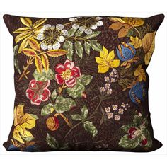 Colorful, hand cut wool felt pillows are skillfully crafted and sewn to create a joyful collection. This design features a vibrant floral motif in rich colors.
