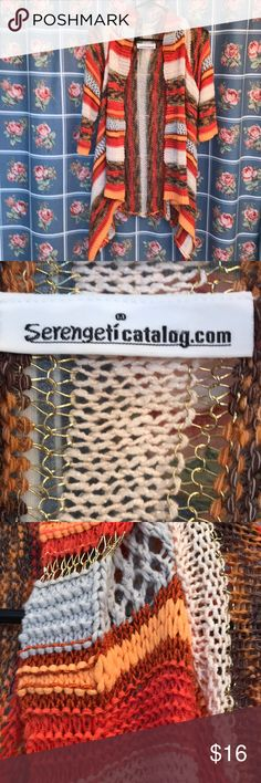 Serengeti catalog knitted look coverup shrug OS Serengeti beautiful coverup shrug nice gold stitching and nice earth colors 19 inches across the top back of shoulder Serengeti Sweaters Shrugs & Ponchos
