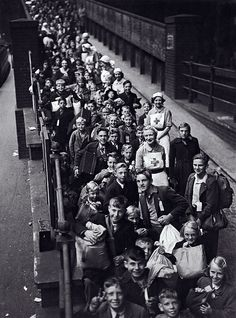 WWII, Britain.  Lines of children at Paddington Station await evacuation from London.