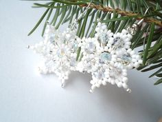 White Snowflake Earrings, Winter Jewelry , Christmas Beaded Star. $5.00, via Etsy.