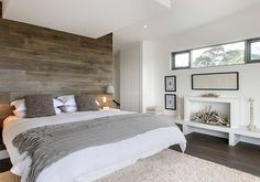 You can put laminate flooring on a wall for a stunning accent wall!