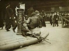 """Crippled Boy Resting Against Fire Alarm"" by the Brown Brothers of New York, NY (1918)."