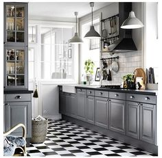 Ikea grey kitchen with black and white tiled floor. Lovely.