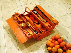 'The carrot farmer's toolbox' [Morotsodlarens verktygslåda] by Anu Tuominen, exhibit at the Nordic Watercolor Museum, Sweden, 2012.   Orange toolbox with orange things. Photo by Vilseskogen, via Flickr (Creative Commons license, free to share if you give credit).