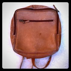 Clave genuine leather backpack. This is the kind of bag you probably go into a boutique to find and fall in love with it. This bag is better! It's genuine leather gives it a buttery feel. It's lived in, which only makes it better! Great condition. Inside is lined and clean. Two inner zipper pockets. This bag can hold so much, and it's also lightweight. I very recently had the main zipper replaced, did not use the bag, but the new zipper is hung up again. Boo! Zipper replacement is no big…