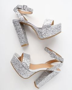 We're starstruck over the Estelle Silver Glitter Platform Ankle Strap Heels! Shimmering silver glitter covers these sky-high heels with a peep-toe upper, toe platform, and an adjustable ankle strap with covered buckle. Fancy Shoes, Pretty Shoes, Beautiful Shoes, Cute Shoes, Me Too Shoes, Ankle Strap Heels, Ankle Straps, Shoes Heels, Pumps