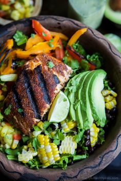 Blackened Grilled Salmon Salad topped with grilled corn, black beans, fresh Pineapple Salsa and a Citrus Cilantro Vinaigrette you'll swoon over! This Salad is what dreams are made of and all packed into a small bowl!   joyfulhealthyeats.com #paleo #glutenfree