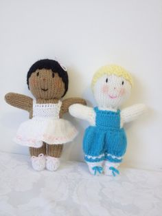 Gorgeous hand knitted pair of little toddler dolls, the girl has a lovely white dress and shoes with pale pink contrast and a little bow in her hair and the boy has on delightful blue rompers with white shoes and blue laces. They are made from a Jean Greenhowe pattern and measure approx 8.5 ins from head to toe. Made entirely from acrylic wool so suitable for even very small babies.