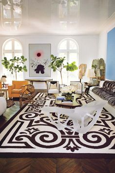 In the living room, Joris Laarman\'s 2006 translucent chaise sits on a c. 1940 Cogolin rug designed by Henri Gonse.