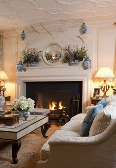 Living room decorated with blue and white transferware.
