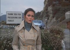 Trench Coat Spy Queen Lynda Carter...  Before the law enforcement putz screws up the photo...