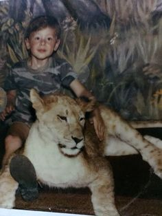 Cory Monteith as a child with a lion