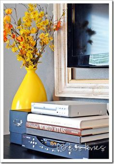 Hide Cable Boxes with books and storage boxes.