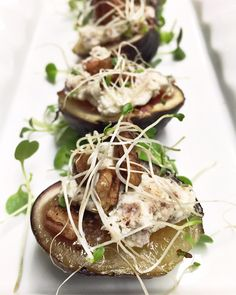 Figs stuffed with goat cheese, country ham, spiced pecans & sprouts
