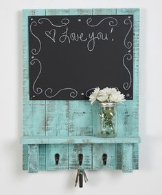 Stay organized with a little rustic flair using this reclaimed wood chalkboard featuring three hooks.