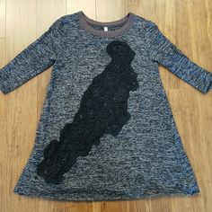 Free People lace front cutout top Good used condition gray and black sweater/shirt with large black lace cutout in front. No signs of wear. Longer length, flares out, great with leggings. Shorter 3/4 arm length. Size S. Measures approx 16 inches armpit to armpit, 27 in length. Just washed and line dried. No trades, PP, or lowball offers please. Cheaper on M. Free People Sweaters Crew & Scoop Necks