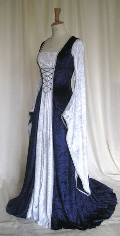 Also beautiful! Except all ivory/white. Maybe do it in a lighter fabric than velvet? Custom Made Wedding Gown. $210.00, via Etsy.