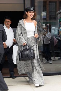 Bella Hadid took a leaf from BFF Kendall Jenner's recent menswear makeover by hitting the streets of NYC in head-to-toe gray plaid on Tuesday.