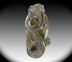 Beautiful hand made wire wrap pendant collaboration. Amethyst, Black Diamonds, Diopside, Sterling Silver, White Gold, Yellow Gold Fill.