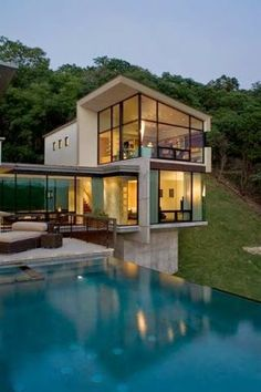 All the way from Texas USA, how about this modern home with spillover pool?