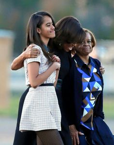 First Lady Michelle Obama (C) with daughter, Malia (L), and mother Mrs. Robinson (R)