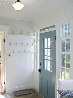 Cute painted (on the inside) door! With white bead board ceiling and light gray walls.