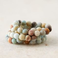 Matte beads of amazonite, Picasso jasper, and picture jasper in complementary colors form this set of stretchy statement bracelets, each one hand-craf