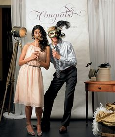 I love this idea with a photo booth for all the bridal party and guests to take funny pictures!