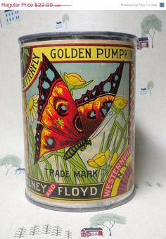 Vintage Advertising Display Can with Olney and Floyd Butterfly Brand Label. Golden pumpkin with beautiful butterfly.