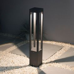 Elipta Matrix Bollard Light with graphite grey finish. Built-in LED warm white lights. Ideal for lighting up along paths, driveways and around decking and terraces.