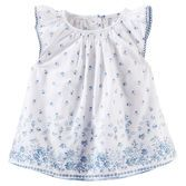 With a porcelain floral print, this dainty top looks super sweet over bubble shorts.<br>