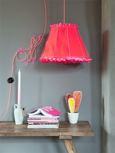 Neon light with accessories against grey wall
