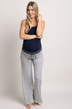 These super comfy maternity pajama pants will be the greatest gift you give yourself! Its ultra-soft terry cloth fabric, classic striped print and the elastic drawstring waist are designed for you to feel great and look adorable. Cozy up this winter by pairing with a comfy maternity top and have a good night's sleep! #pregnancypants,