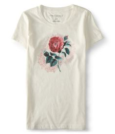 """A lone rose blooms atop an exotic mandala on the front of our soft Solo Rose Graphic T, giving it a mysterious, feminine air. Pair it with skinny jeans, heels and dark-tinted shades, and you can't go wrong, darling!<br><br>Slim fit. Approx. length (S): 25.5""""<br>Style: 3679. Imported.<br><br>60% cotton, 40% polyester.<br>Machine wash/dry."""