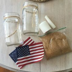 Quickly make USA themed candle holder by adding American flags to mason jars
