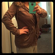 DONATED Love this jacket I just purchased this on poshmark and it's in good condition but I can't button it comfortably over my chest and is tighter in the arms. I'm 5'0 and this jacket hits right below my toosh! Super cute can go with anything it's a brownish color with a removable fur lined collar and a hidden hood! Lots of pockets and drawstring at waist to adjust the the fit. Make me an offer! 😊 Jackets & Coats