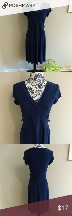 Navy blue Faux Wrap Dress Navy blue faux wrap dress from Janette. It is in great condition but is missing the fabric belt  All approximate measurements are take flat and unstretched.   Bust 18 inches Waist 15 inches  Length 39.5 inches Janette Dresses