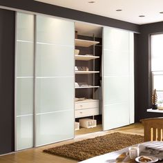 Contemporary white glass sliding wardrobe doors. Available from our store in South Wales for home delivery throughout the UK mainland: http://www.slidingwardrobesuk.co.uk/acatalog/Contemporary-Mirror---Glass-Sliding-Wardrobe-Doors.html