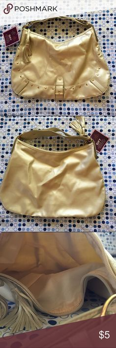 Gold Hobo Bag This bag is NWT. It is cute and simple. It has one small scratch pictured above. The inside of the bag does not have any pockets or compartments. Bags Hobos