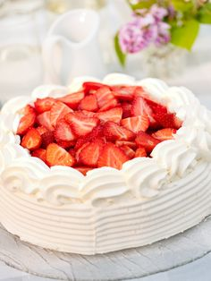 Strawberry Cake. Traditional Swedish baking follow the seasons of the countryside. As the strawberries are ripe and juicy at this time of the year, the Swedish Strawberry Cake is a must for the midsummer lunch or fika.  Credits: Jakob Fridholm/imagebank.sweden.se